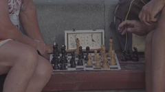 Close the frame. Chess. Hands chess players. A game. Retired. Summer. Russia. Stock Footage