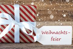 Present With Snowflakes, Weihnachtsfeier Means Christmas Party Stock Photos