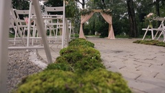 Wooden arch with curtains, flowers for ceremony on wedding day Stock Footage