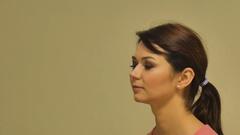 Make-up artist doing make-up powder causes a large brush close-up shot Stock Footage