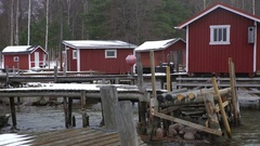 A lot of small fish houses for fishing gear and boats on Baltic sea in winter. Stock Footage