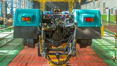 Conveyor assembly stage the body of tractor at factory timelapse Stock Footage
