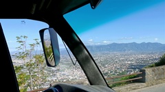 Driving in the narrow streets of Sorrento, Italy, view to Pompei valley Stock Footage