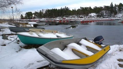 Fishing boats, snow and lead-gray water of the Baltic Sea. Dolly shot. Stock Footage