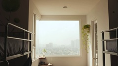 A room in a hostel with views of the city Stock Footage