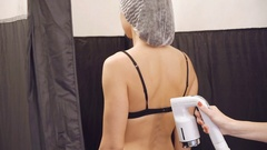Girl on the body instant tan in beauty salon Stock Footage