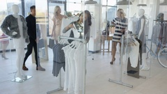 4K Customers shopping & clerk giving assistance in boutique clothing store Stock Footage