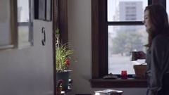 Young Woman Takes Care Of House Plants, Carefully Waters Plants In Her Apartment Stock Footage