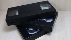 Stack of VHS video tape cassette Stock Footage