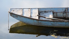 Old boat in calm water Stock Footage