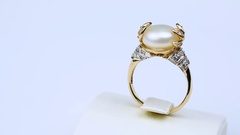 Jewerly gold ring is with white pearl on white backgroung Stock Footage