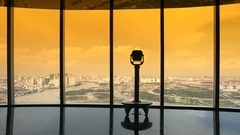Turis looking through binoculars on observation deck in tower Ho Chi Minh city Stock Footage