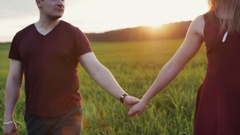 Couple walk in beautiful place at sunset, hold hands. Lovers hug tenderly. Woman Stock Footage