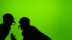 Two football players face each other. Slow motion. Green screen Stock Footage