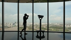 Photographer takes pictures on observation deck in tower Ho Chi Minh city Stock Footage