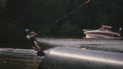 Man wakeboard slides on the tube Stock Footage