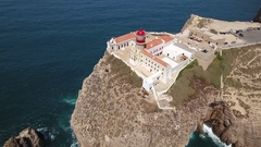 Aerial. Movies with sky above the southern lighthouse Cabo Sao Vicente Stock Footage