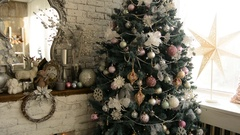 Christmas tree and fireplace with an armchair Stock Footage