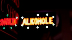 Illuminated sign «Аlcohol», blurred into the darkness. Stock Footage