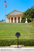 The Eternal Flame and the Robert E. Lee house at Arlington Natio Stock Photos