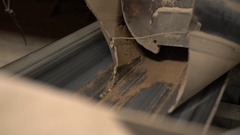 View of sand pours on conveyor belt, close-up Stock Footage