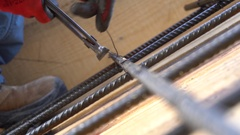 Construction worker working on steel rods used to reinforce concrete Stock Footage