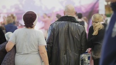 Crowd in mall: people looking at dancing couples on open air boogie-woogie rock Stock Footage