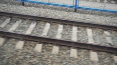 View on the rails from the window of moving train Stock Footage