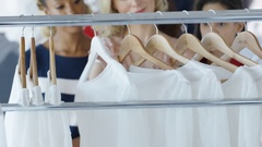 4K Female friends shopping together in fashionable clothing store Stock Footage