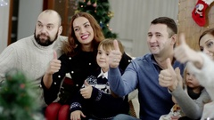 Happy families showing thumb up at christmas party Stock Footage