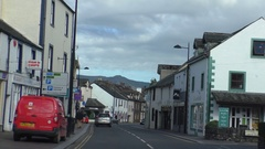 Car driver view in Keswick town, England Stock Footage