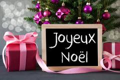 Tree With Gifts, Bokeh, Text Joyeux Noel Means Merry Christmas Stock Photos