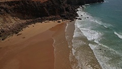 Aerial.Videography over a mountain Tonel beach, surfers Stock Footage