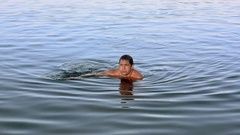 Adult man go on bottom of lake by hands in summer sunny day. Weekend. Nature Stock Footage