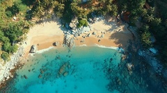 Aerial: Landing on the wild beach with beautifull water. Stock Footage