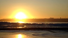 Winter sunset over a big river. The river is covered with ice. Stock Footage