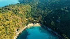 Aerial: Small wild Nui beach on Phuket island. Stock Footage