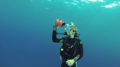 Group of divers swim underwater. Plunging on depth. Scubadiving. Bubbles Stock Footage
