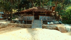 Aerial: Bar-bungalow on the wild beach. Stock Footage