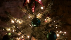 Big red star on top Christmas green tree Stock Footage