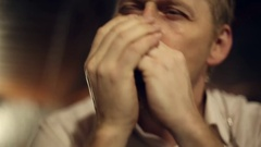 Musician plays the harmonica Stock Footage