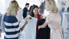 4K Female friends shopping take their purchases to the sales counter Arkistovideo