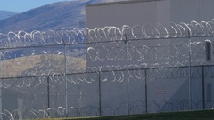 Razor wire double layer prison fence. Stock Footage
