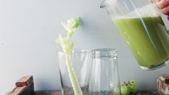 Grapes and Celery Smoothie being poured. Overflow Stock Footage