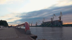 Cargo port at seafront. River. Cranes. Containers. Summer. Men on roller skaters Stock Footage