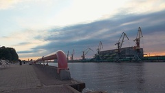 Cargo port at seafront. River. Cranes. Containers. Summer evening. Nobody Stock Footage