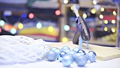 Creative Christmas table with glue gun, baubles and empty wreath 4K Stock Footage