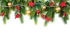Christmas border with trees, balls, stars and other ornaments, isolated on white Stock Photos