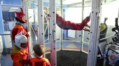 Boy learning to fly in aero tube Arkistovideo