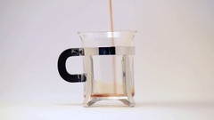 Close up of a mug in glass with dark black coffee Stock Footage
